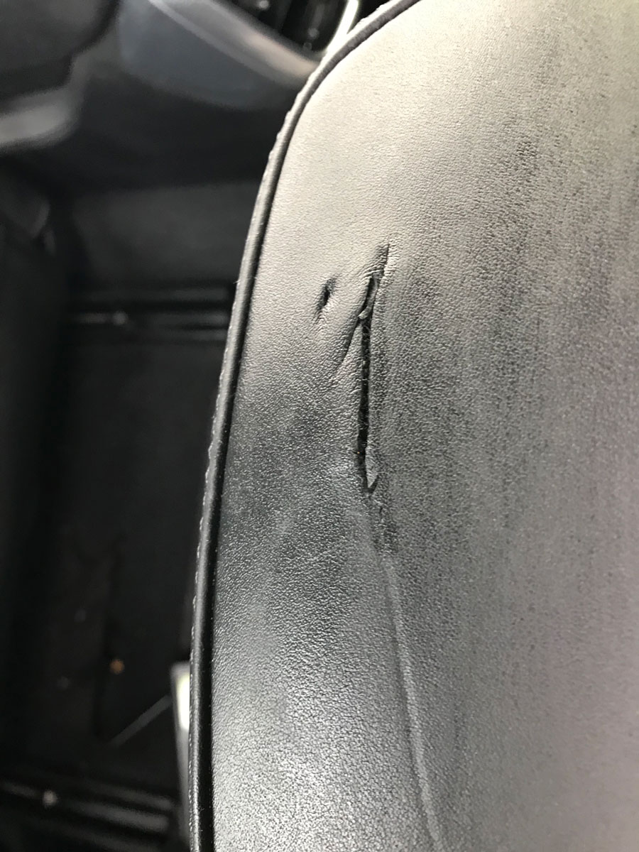 Car headrest damage on Porsche Cayenne
