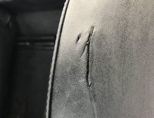 Car headrest damage repaired on Porsche Cayenne